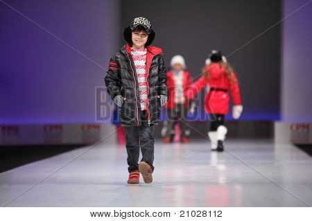 MOSCOW - FEBRUARY 22: Unidentified child models wear fashions from Snowimage, walk catwalk in Collection Premiere Moscow, main platform of fashion industry in Eastern Europe, on February 22, 2011 in Moscow, Russia