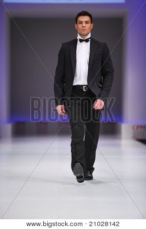 MOSCOW - FEBRUARY 22: A model wears a black suit from Slava Zaytzev and walk the catwalk in Collection Premiere Moscow, a leading fashion fair in Eastern European market, on February 22, 2011 in Moscow, Russia.