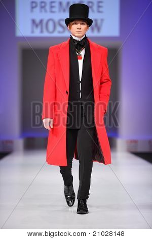 MOSCOW - FEBRUARY 22: A model wears coat and top hat from Slava Zaytzev and walks catwalk in Collection Premiere Moscow, leading fashion fair in Eastern European market,  February 22, 2011 in Moscow, Russia.