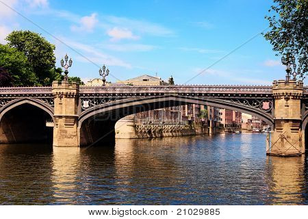 Famous bridge and  River Ouse with reflections in York UK