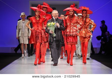 MOSCOW - FEBRUARY 22: Couturier Slava Zaytzev and models wear his clothing in the Collection Premiere Moscow, a fashion industry platform of IGEDO Company, on February 22, 2011 in Moscow, Russia.