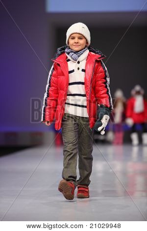 MOSCOW - FEBRUARY 22: An unidentified child model wear fashions from Snowimage and walk catwalk in Collection Premiere Moscow, an international fashion fair for Eastern Europe, on February 22, 2011 in Moscow, Russia.