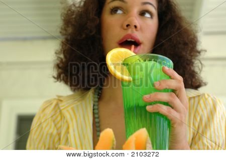 Attractive Young Woman Drinking Lemonade