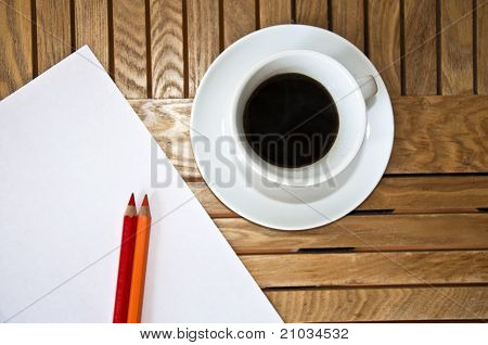 Paper blank Sheet color pencil and a cup of coffee