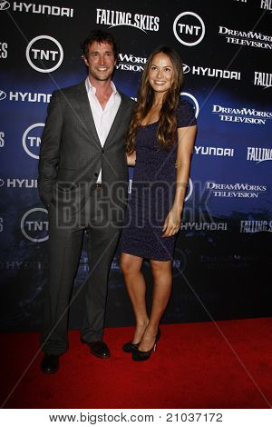 LOS ANGELES - JUN 13: Noah Wyle, Moon Bloodgood at the premiere of TNT's 'Falling Skies' held at the Pacific Design Center on June 13, 2011 in Los Angeles, California.