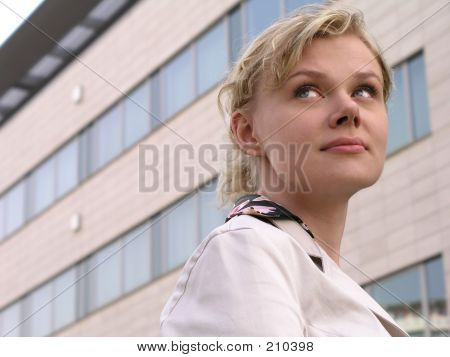 Businesswoman Standing Outside A Modern Office Building