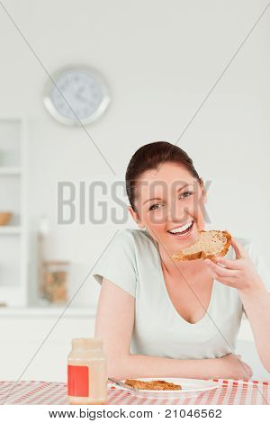 Good Looking Female Preparing A Slice Of Bread And Marmalade