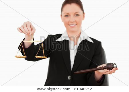 Young Woman Holdind The Justice Symbols