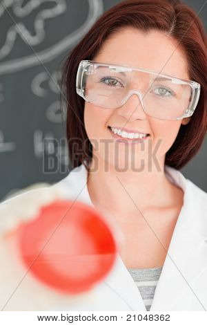 Portrait Of A Gorgeous Scientist Holding A Petri Dish With The Camera Focused On The Model