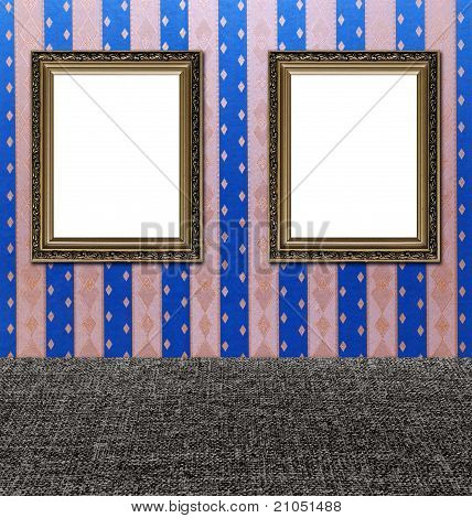 Two Old Style Vintage Golden Ornament Frames On Textured Pink And Blue Wallpaper And Textile Floor B