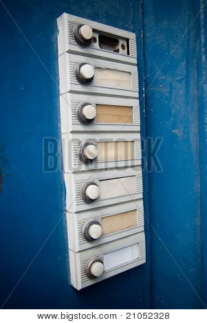 Old intercom in a blue wooden door