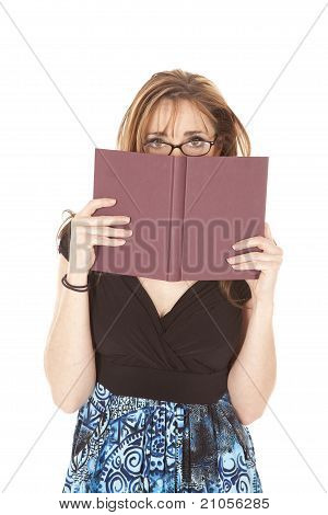 Woman Is Looking Over Book