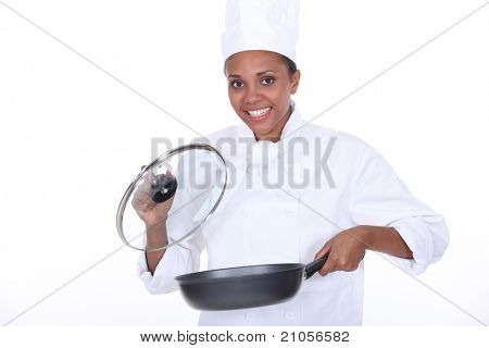 female chef exhibits a frying pan