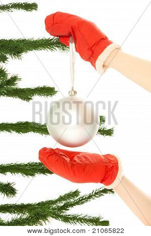 Woman's Hands Holding Christmas Toy