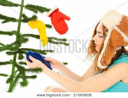 Woman Dressing Christmas Tree