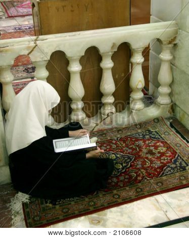 Veiled Girl With Quran
