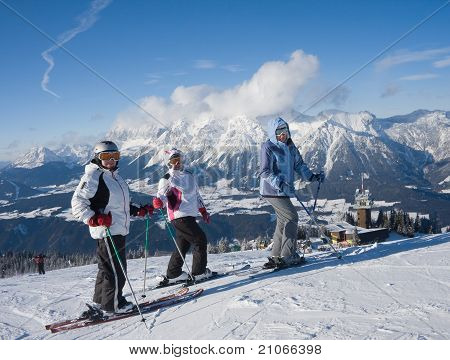 Skiers Mountains In The Background