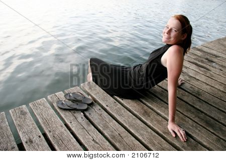 Young Woman Relaxing At Lake