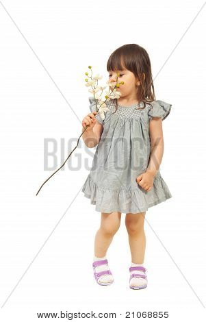 Little Girl Smelling Orchid