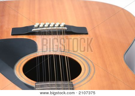 Guitar Closeup Of Soundhole, Bridge And Lower Body