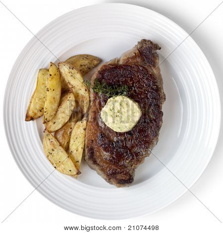 Grilled rib-eye steak with herbed butter and potato wedges, garnished with thyme.