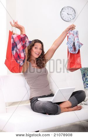 Brunette shopping online at home