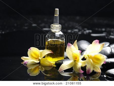 Spa still life with bottle of essential oil orchid