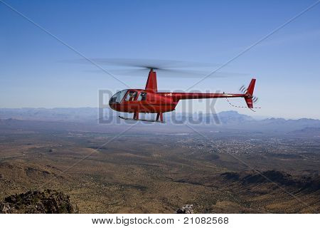 Helicopter over Desert Landscape