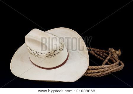 Cowboy Hat And Lasso On Black