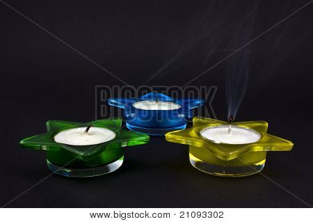 Three extinguished candles