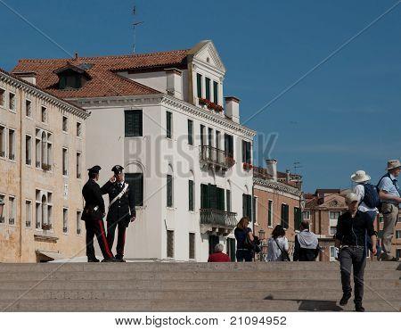 Italian police watch the Venice crowds.