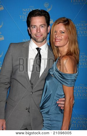 LOS ANGELES - JUN 17:  Michael Muhney, Michelle Stafford arrive at the 38th Annual Daytime Creative Arts & Entertainment Emmy Awards at Westin Bonaventure Hotel on June 17, 2011 in Los Angeles, CA