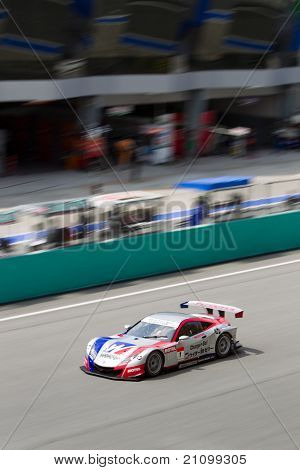 Portrait view of Team Weider Honda Racing at the Malaysian SuperGT race