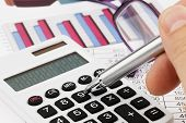 stock photo of subtraction  - A calculator with graphics of a balance sheet - JPG