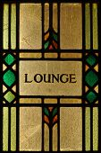 stock photo of stained glass  - A stained glass lounge sign lit from behind - JPG