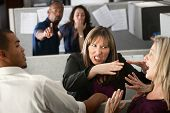 stock photo of strangling  - Two female coworkers fight in office cubicle - JPG
