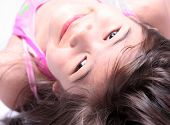 Little Girl Smilnig Upside Down Into Camera