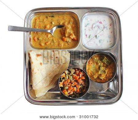Traditional Indian Bread Chapati With Curries, Raitha