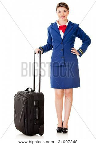 Air hostess with her bag ready to board - isolated over a white background