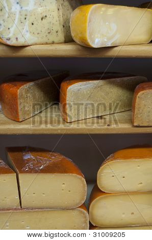 Cut cheese on shelves in store