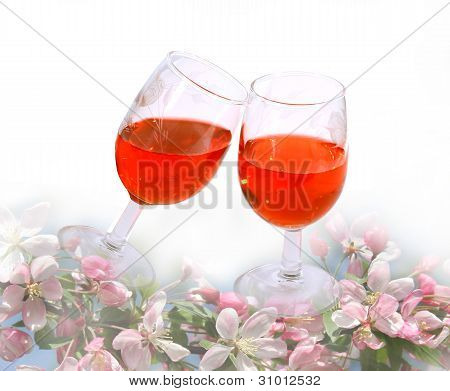 wine glasses  among spring flowers