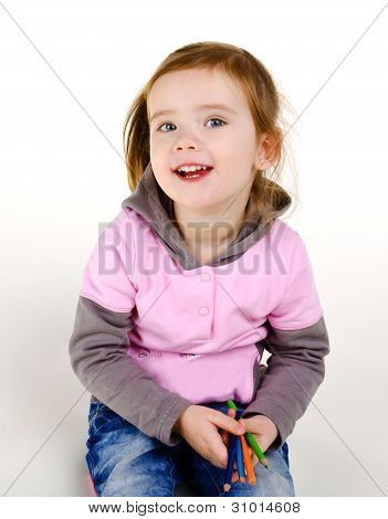 Portrait Of Smiling Little Girl With A Pencils