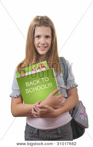 Smiling girl with schoolbag on her back and books and notebooks in her hands