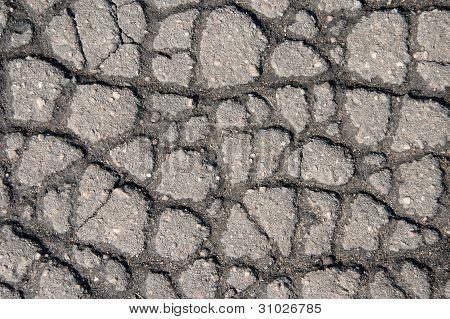 Grietas en el pavimento gris