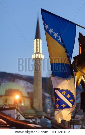 Two Bosnian flags and mosque