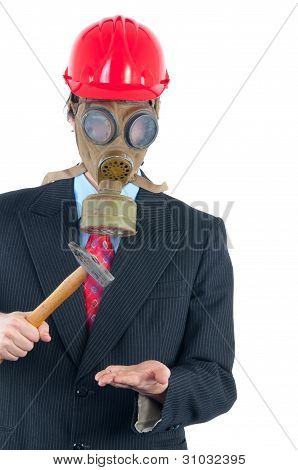 Business man with gas mask and helmet isolated on white striking with hammer imagined object in his
