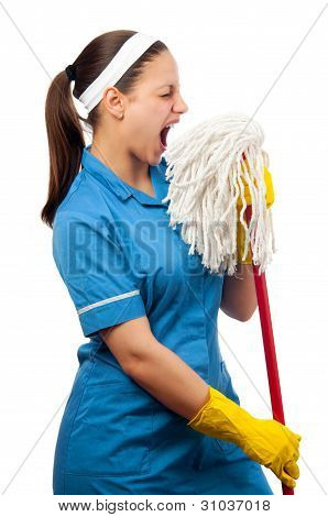 Beautiful young cleaning lady pretending to be a singer isolated on white