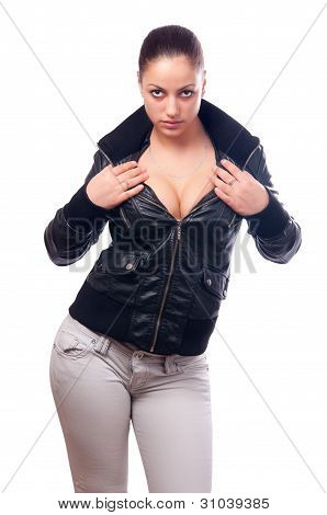Beautiful girl in black leather jacket and jeans isolated on white background