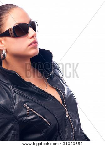 Beautiful girl in black leather jacket and sunglasses isolated on white background