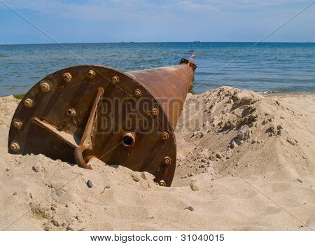 rusted pipe in sea